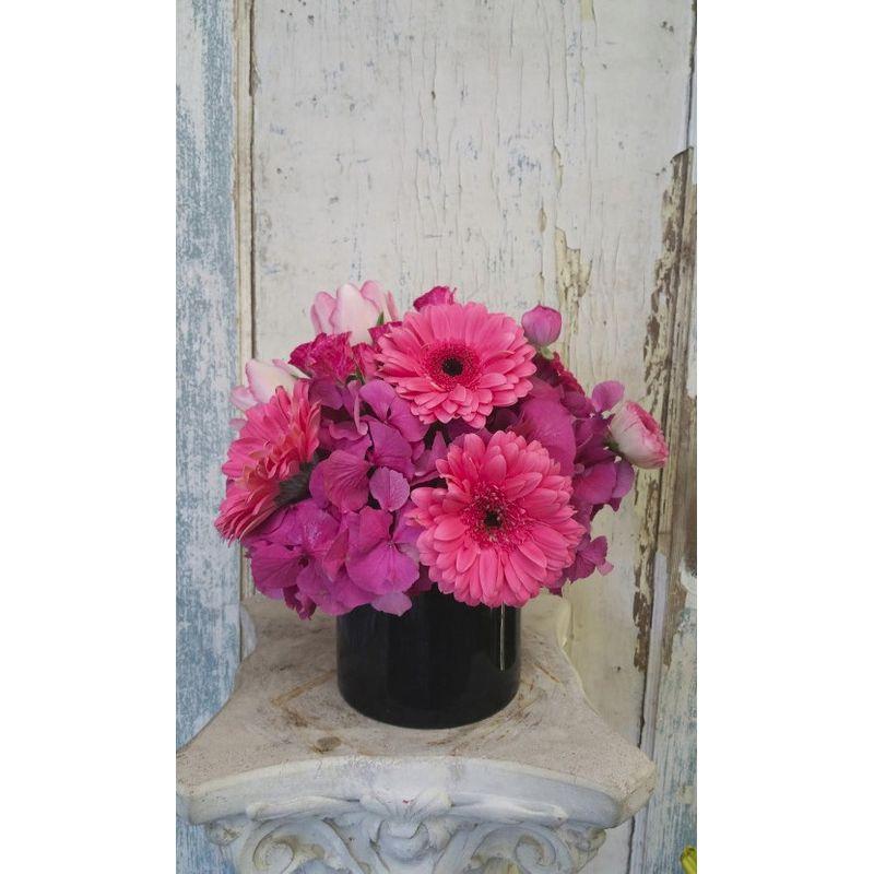Pink flowers in black vase angelas flowers gifts ojai florist more views mightylinksfo