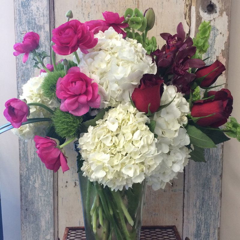 Large Vase Arrangement In Pinks Reds And Whites With Hydrangeas