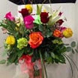 Spring flowers designs by gail argyle floral boutique justin april showers and colorful flowers mightylinksfo