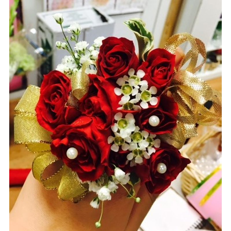 Red rose with gold ribbon wrist corsage