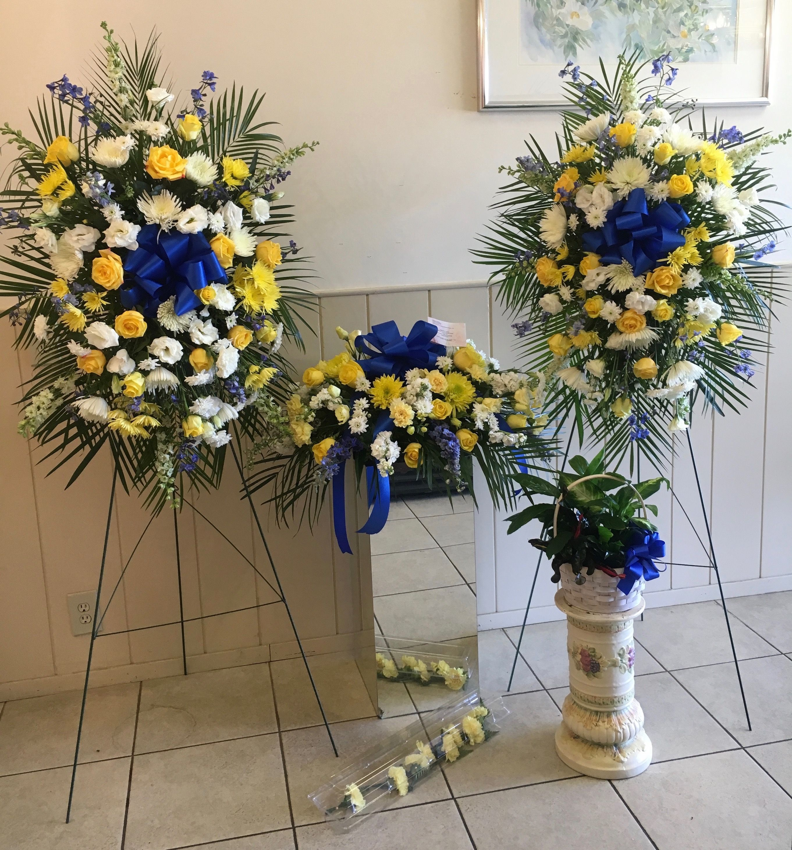 Funerals elegant flowers fresno florists flowers in fresno ca includes 1 casket spray 1 standing spray medium live plant your choice of another standing spray open wreath open heart or cross izmirmasajfo