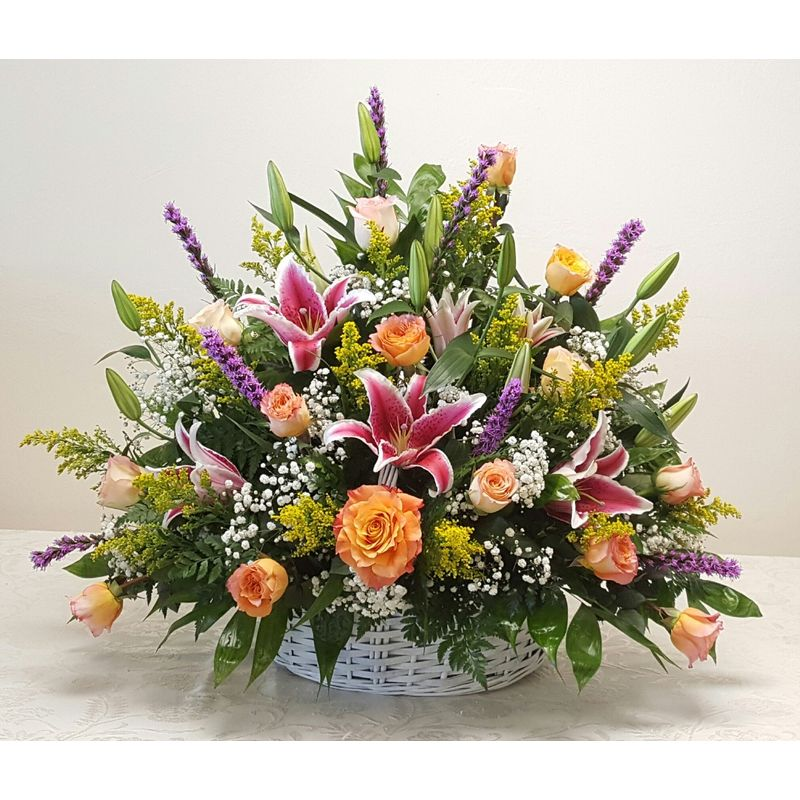 PINK AND PURPLE MIXED FUNERAL BASKET Tallahassee florist