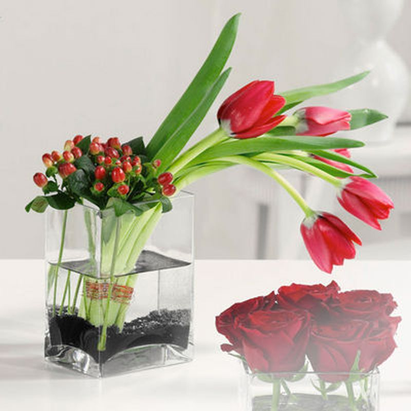 Tulips And Hypericum In Glass Vase Through The Looking Glass