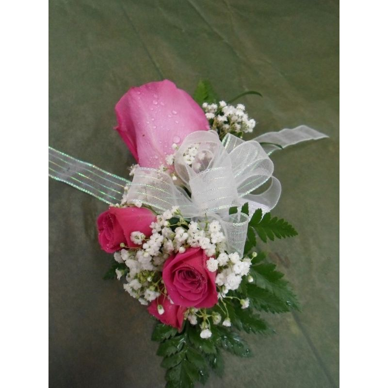 Hot pink rose wrist corsage the flower shoppe poquosons choice more views mightylinksfo